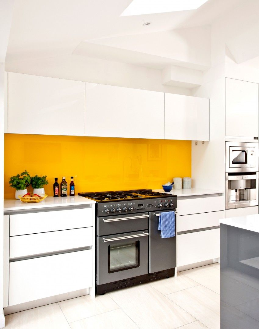 White modern kitchen with yellow splashback yellow interiors decor pinterest modern white Kitchen design yellow and white