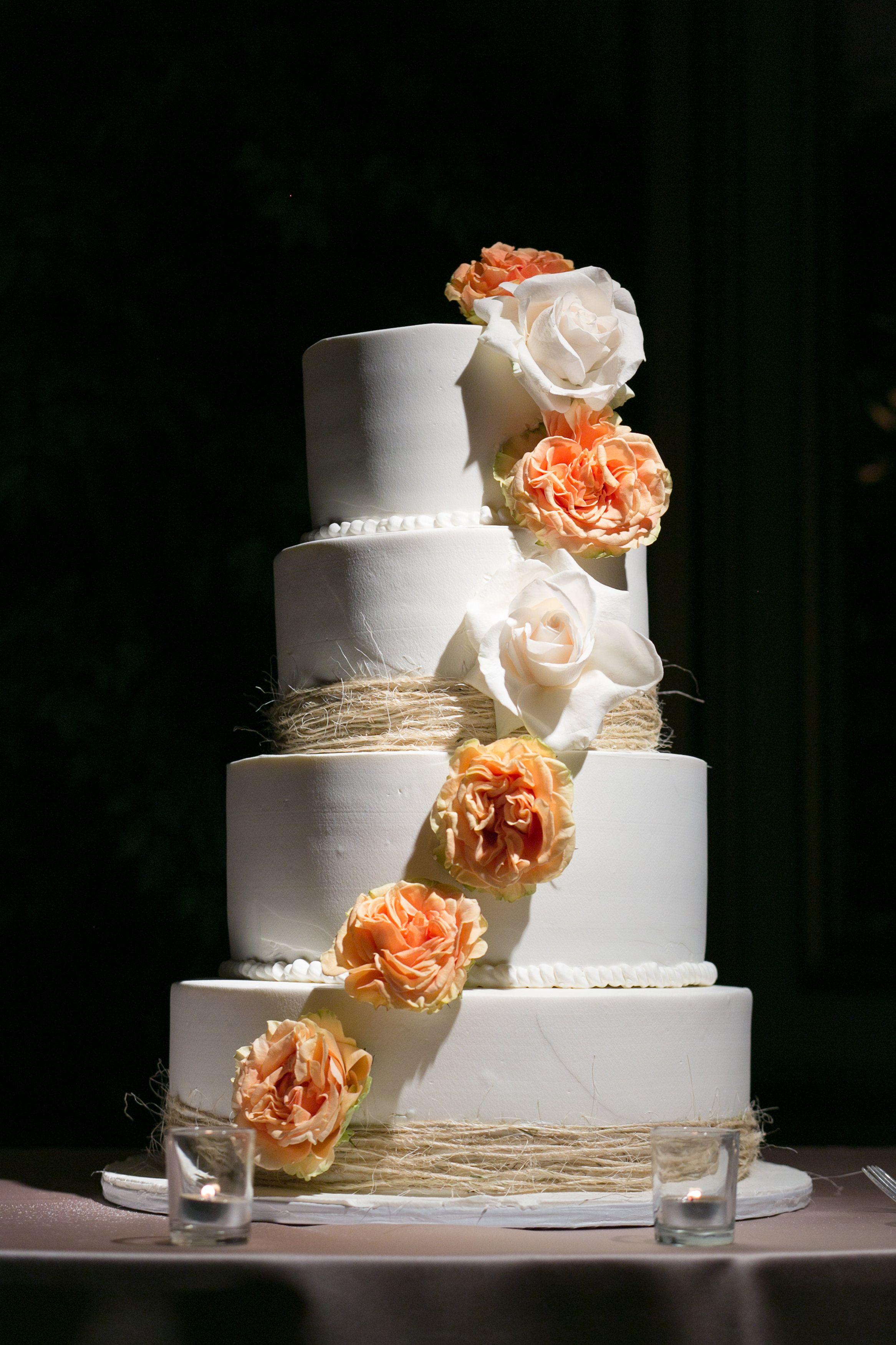 Wedding cake with cascading #coralroses #beachweddingcake