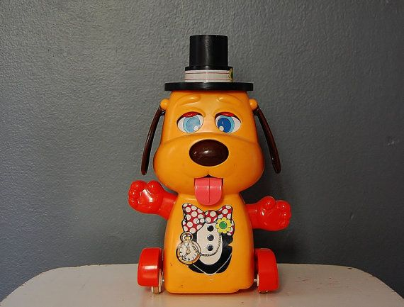 Tomy Dog Toy Orange And Red With Pocket Watch And Black Top Hat