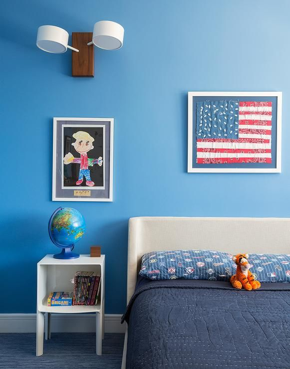 Blue Boy S Bedroom Features A Wall Painted Ocean Blue Lined With A