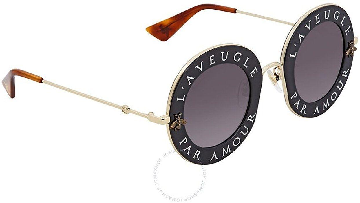 3c4d22670f6 Amazon.com  Sunglasses Gucci GG 0113 S- 001 BLACK   GREY GOLD  Clothing