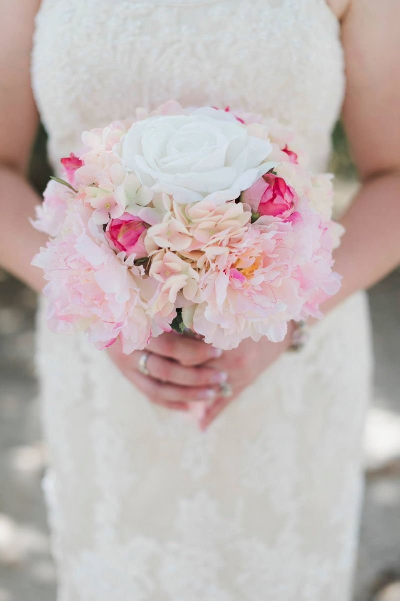 Destination wedding in St. Thomas, the bride packed one of our silk bouquets for her wedding and gets to keep it as a keepsake! Photography by Elisha Orin Photography. See more here: http://www.hollysweddingflowers.com