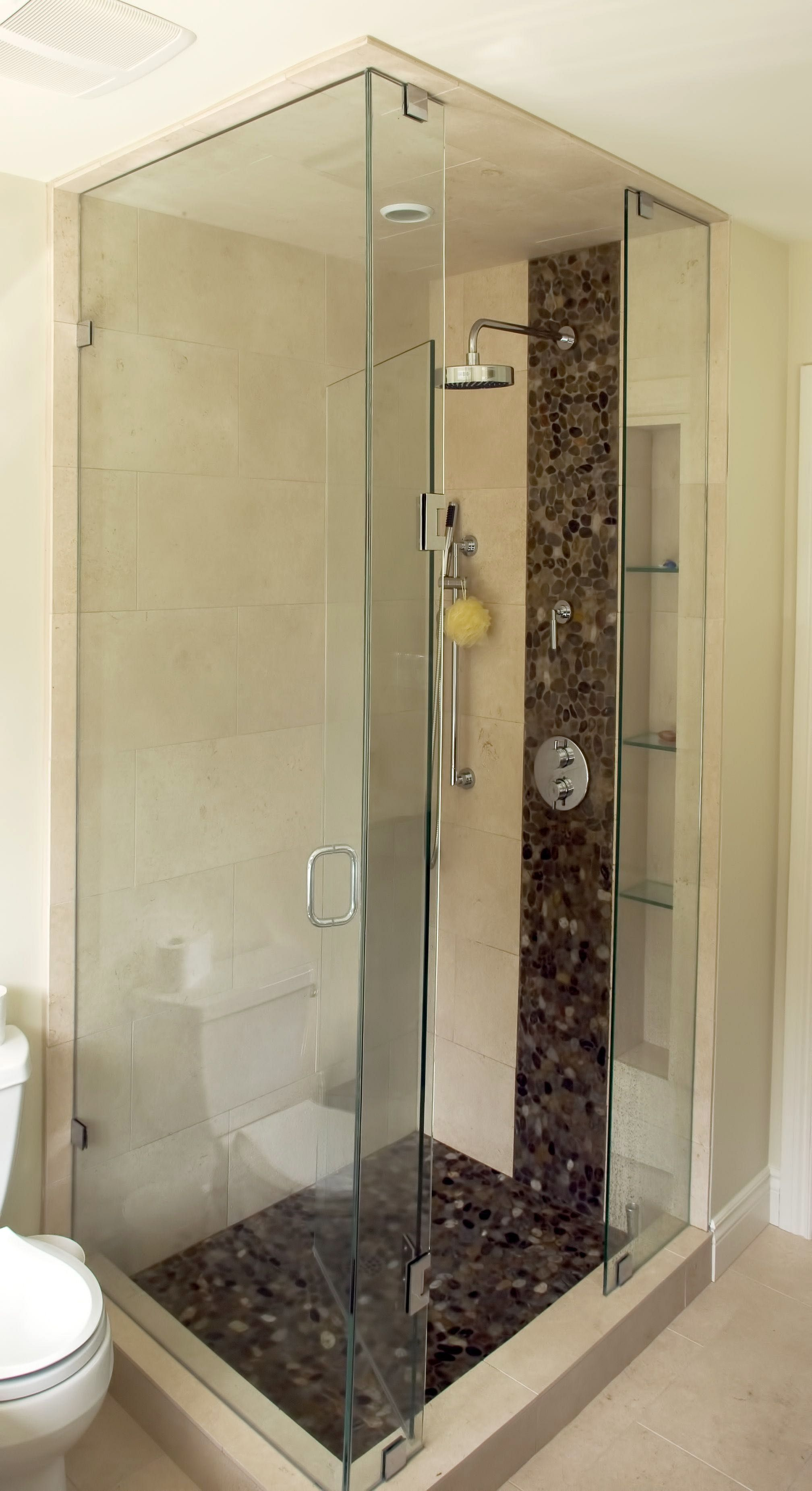 Glass Enclosed Shower With Pebble Tile Feature Custom Built By