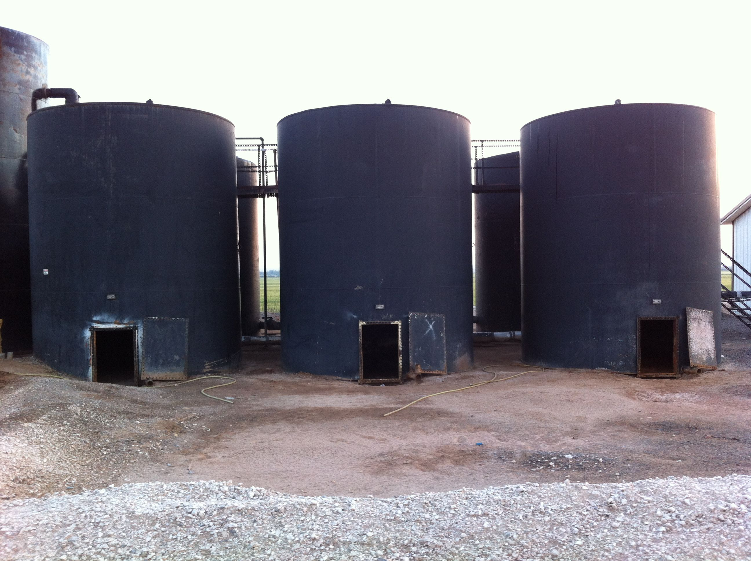 Oilfield storage tank battery | Oil & Gas is Our Business