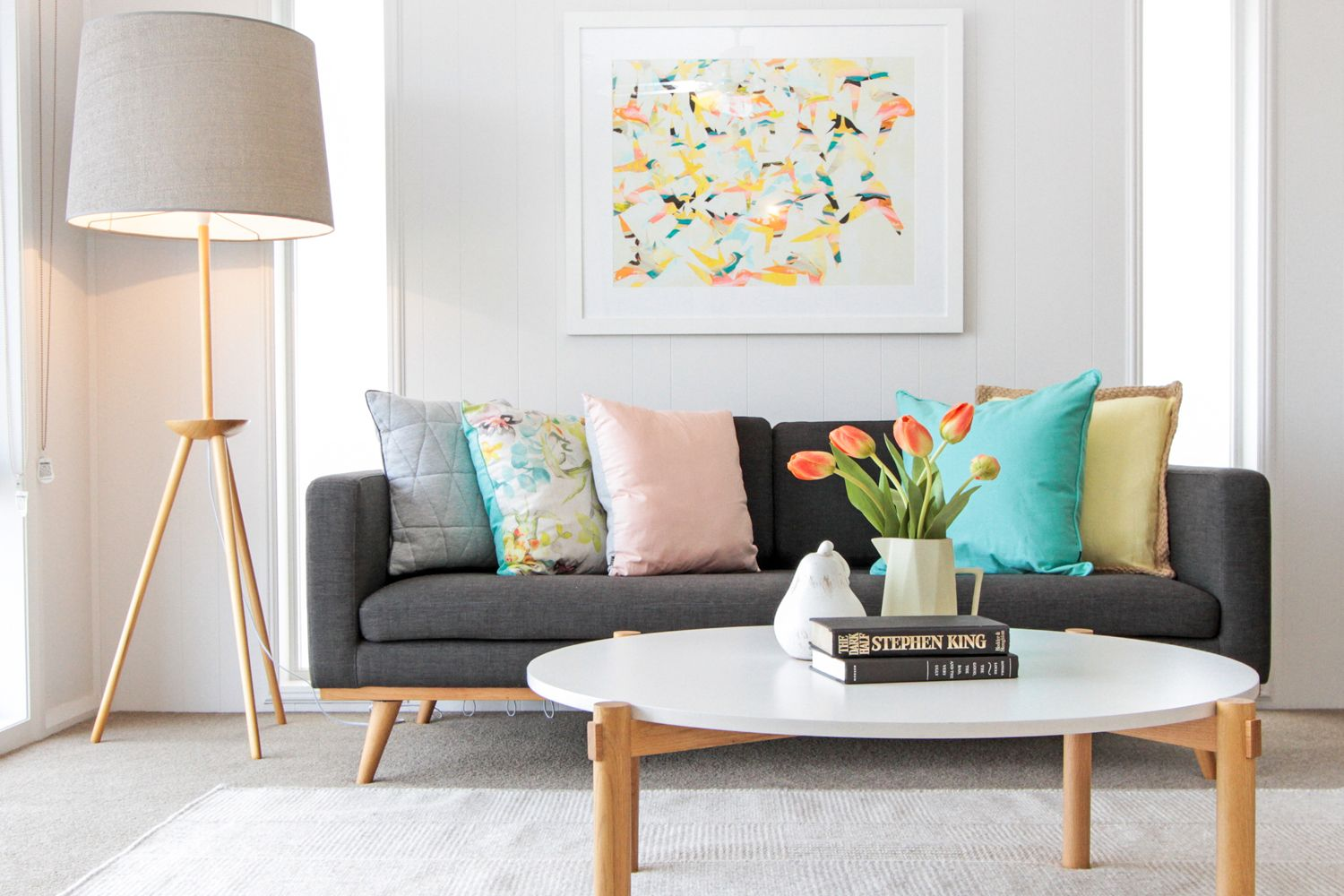 Bright colourful lounge room grey sofa round coffee table | living ...