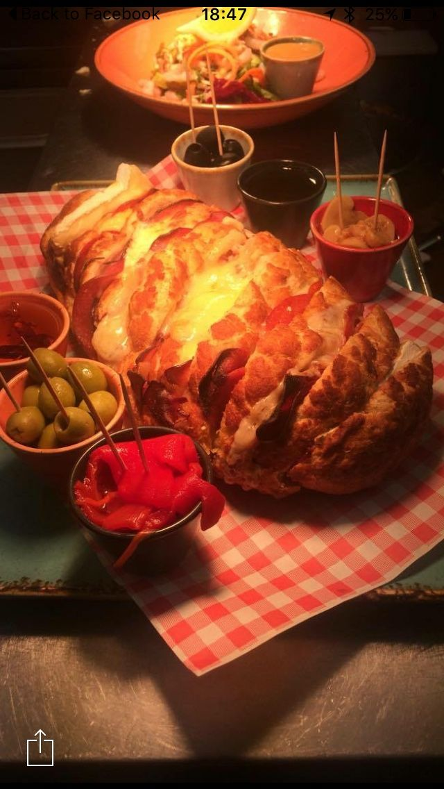 New on the menu: Freshly baked tiger loaf stuffed with continental meats and melted cheeses served with olives and drizzling oils. Delicious!