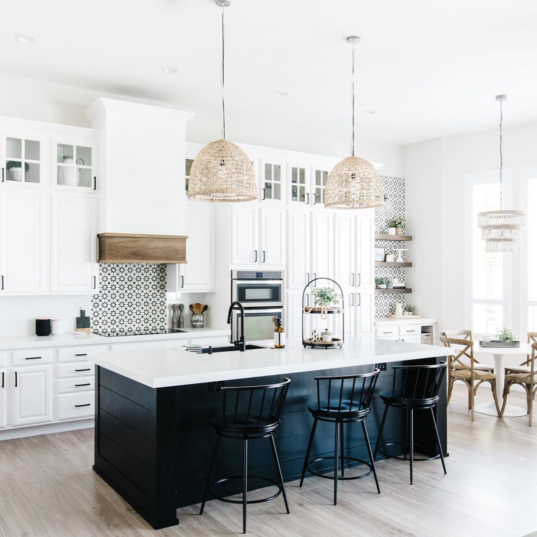 Black Shiplap Island And White Cabinets With Touches Of Natural Wood And Woven Pendants Ove White Modern Kitchen Black Kitchen Island Modern Kitchen Renovation