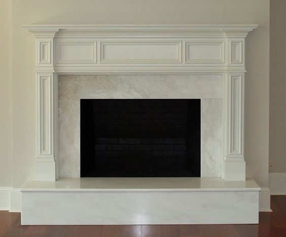 stacked stone fireplace with wood mantle and corbels granite ...