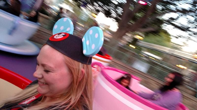 Taren taking a ride on the #Teacups at #Disneyland - proof that #Covears stay on at mad party speeds!