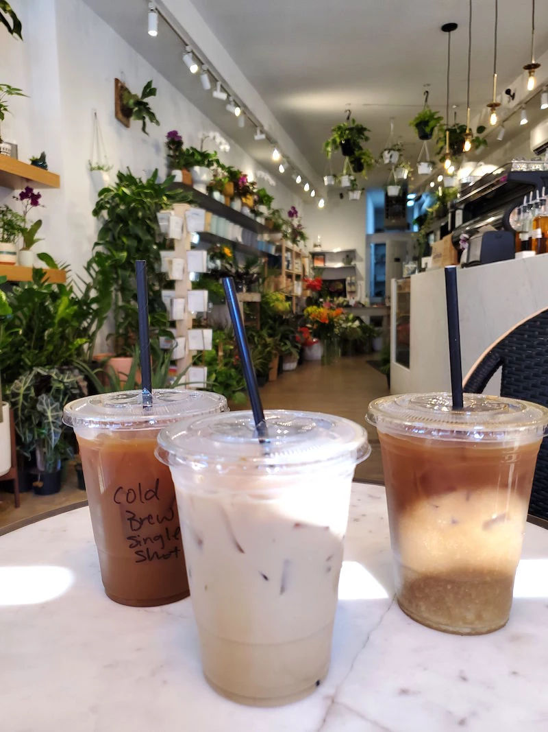 A Dreamy Coffee Shop Inside The Cutest Flower Bodega In 2020 Coffee Shop Cute Coffee Shop Coffee To Go