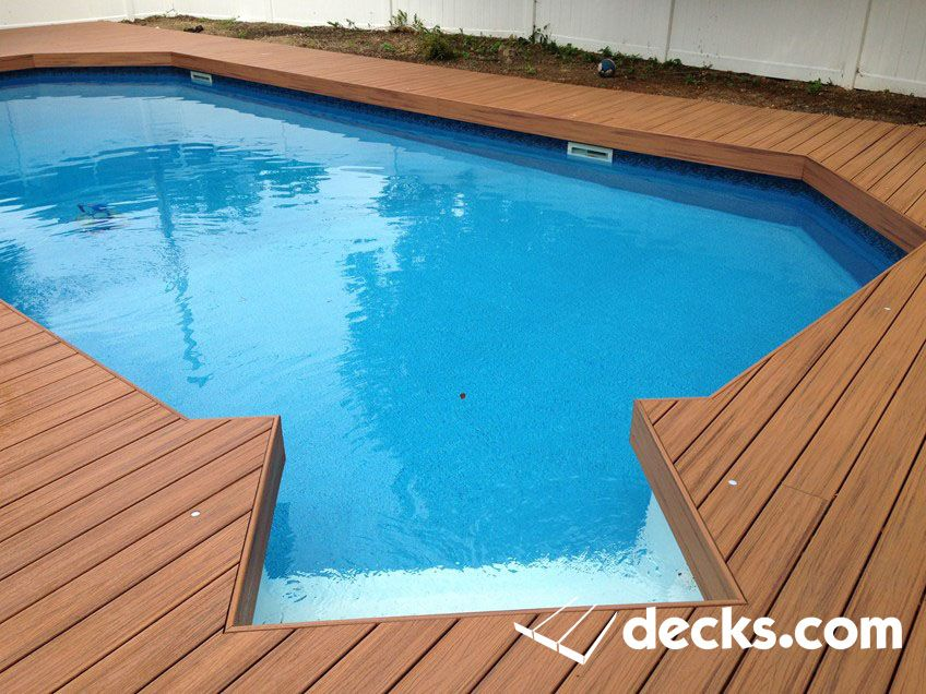 A Composite Deck Wraps Around An In Ground Pool Decks