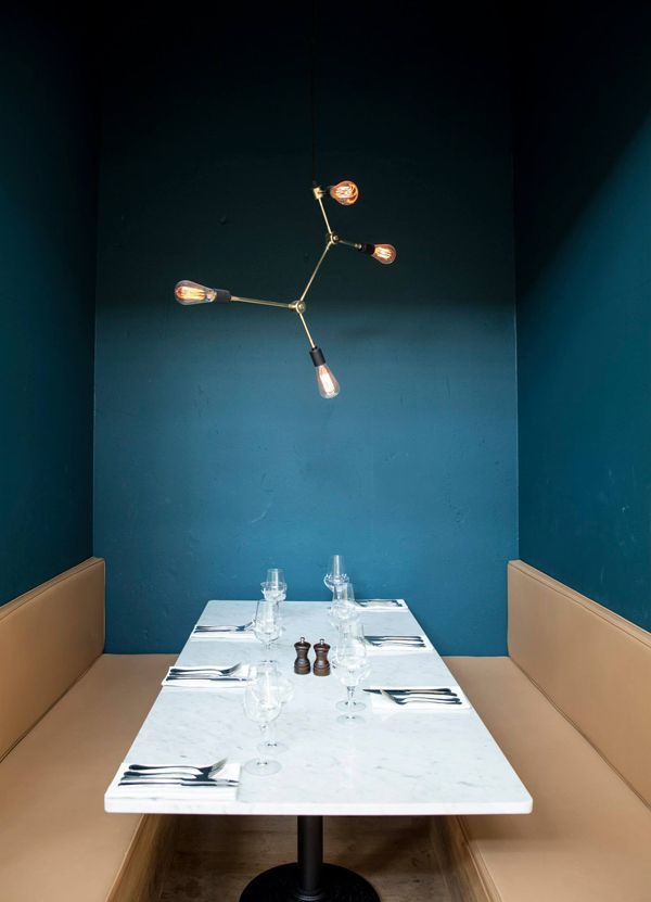 booth niche with walls & low celing same color w/ pendant above  COPENHAGEN RESTAURANT ITALY DESIGNED BY NORM | THE STYLE FILES