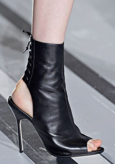Victoria Beckham Black peep-toe stiletto boots with cutout heel counter, S/S 2013 Collection. [Image: vogue]