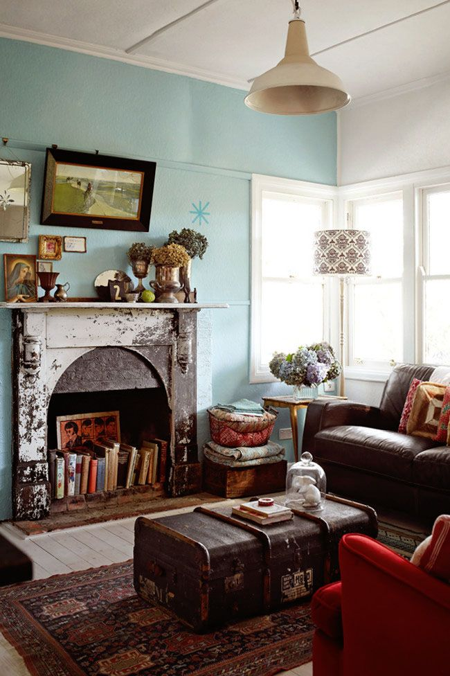 ZsaZsa Bellagio: Vintage Eclectic Charm:  I like the vintage charm in this living-room, especially the fireplace, with it's worn paint and using the hearth as a bookcase.