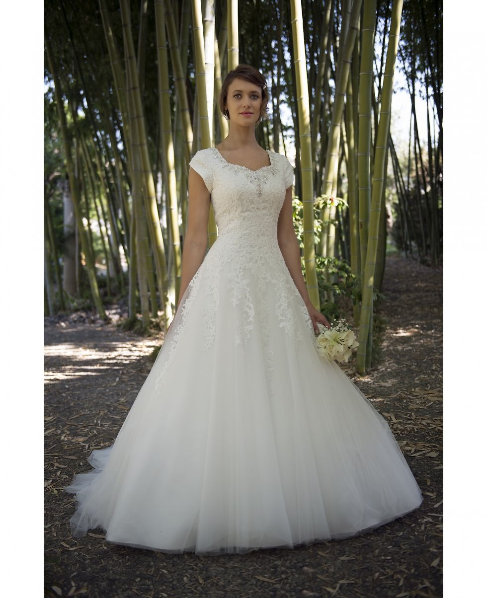 Modest wedding dress with cap sleeves, ballgown tulle skirt and lace ...