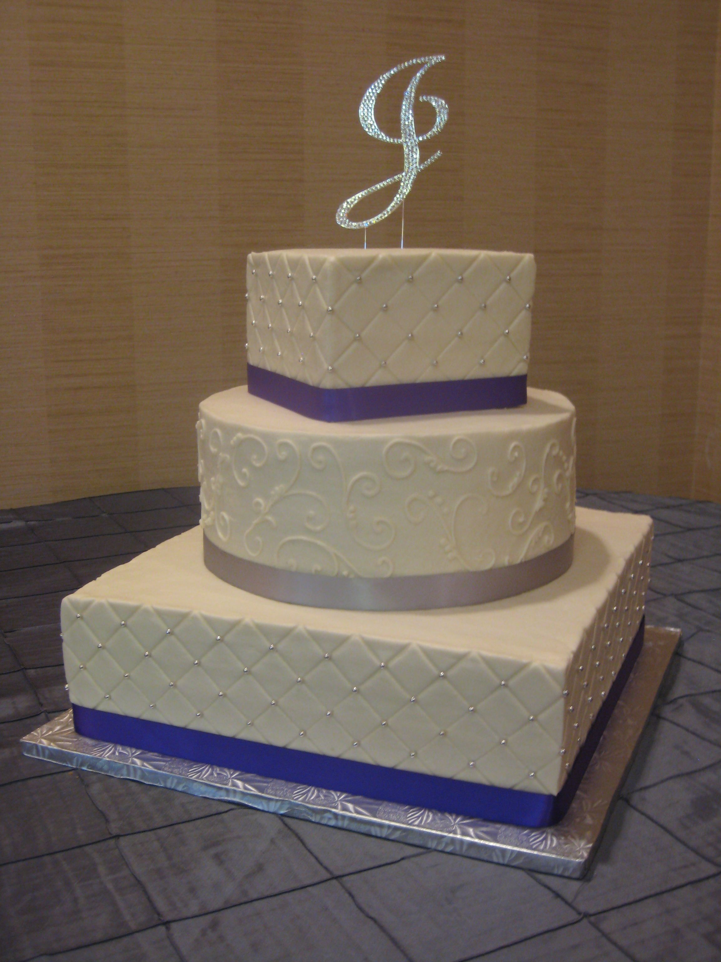 3 tier square and round wedding cake with diamond impression and