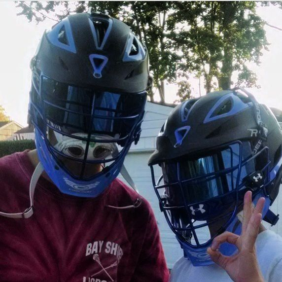 Shoc Mirror Blue Inserts Installed Into Cascade Lacrosse Matte Black And Blue Trim Helmets In Under Armour Visors Shoc Is Proud Lacrosse Lacrosse Boys Helmet