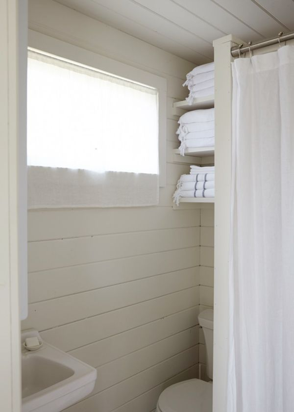A Small Bathroom Makes The Most Of Storage In This Beach Cabin House Tour |  Via