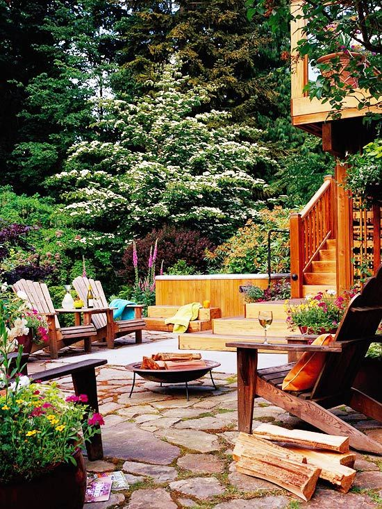 In designing my new patio, I'd planned for adirondack chairs and a firepit, but this photo reminded me to include a hot tub!! How on earth had I forgotten that important detail??? No outdoor retreat is complete without a hot tub!
