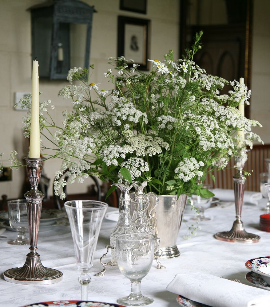 Daisies and queen anne 39 s lace held in a silver plated for Silver centerpieces for dining table
