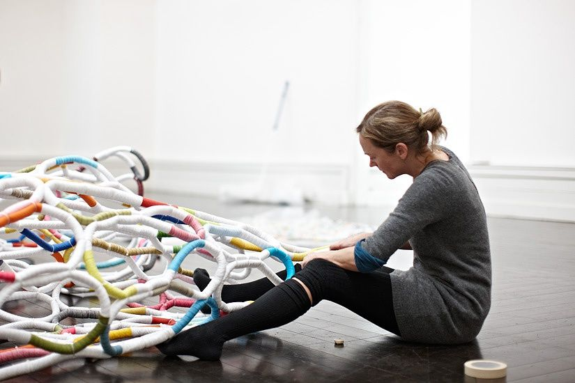 "Artist Louise Campbell installing a large work made from bias binding called"" it's complicated"" at the Center for Contemporary Art in Copenhagen."