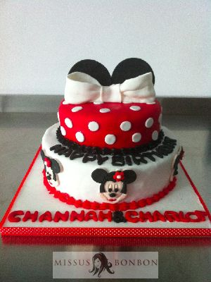 A Minnie Mousethemed birthday cake for a pair of 4year old twin