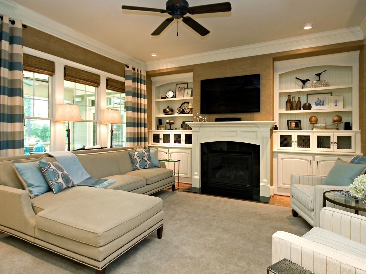 Matching White Builtins Flank The Traditional Fireplace In This Cool Family Living Room Interior Decorating Inspiration