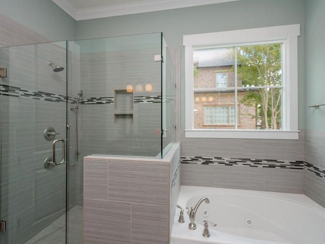 The Master Bath Has A Large Glass Door Shower And A Spa Tub