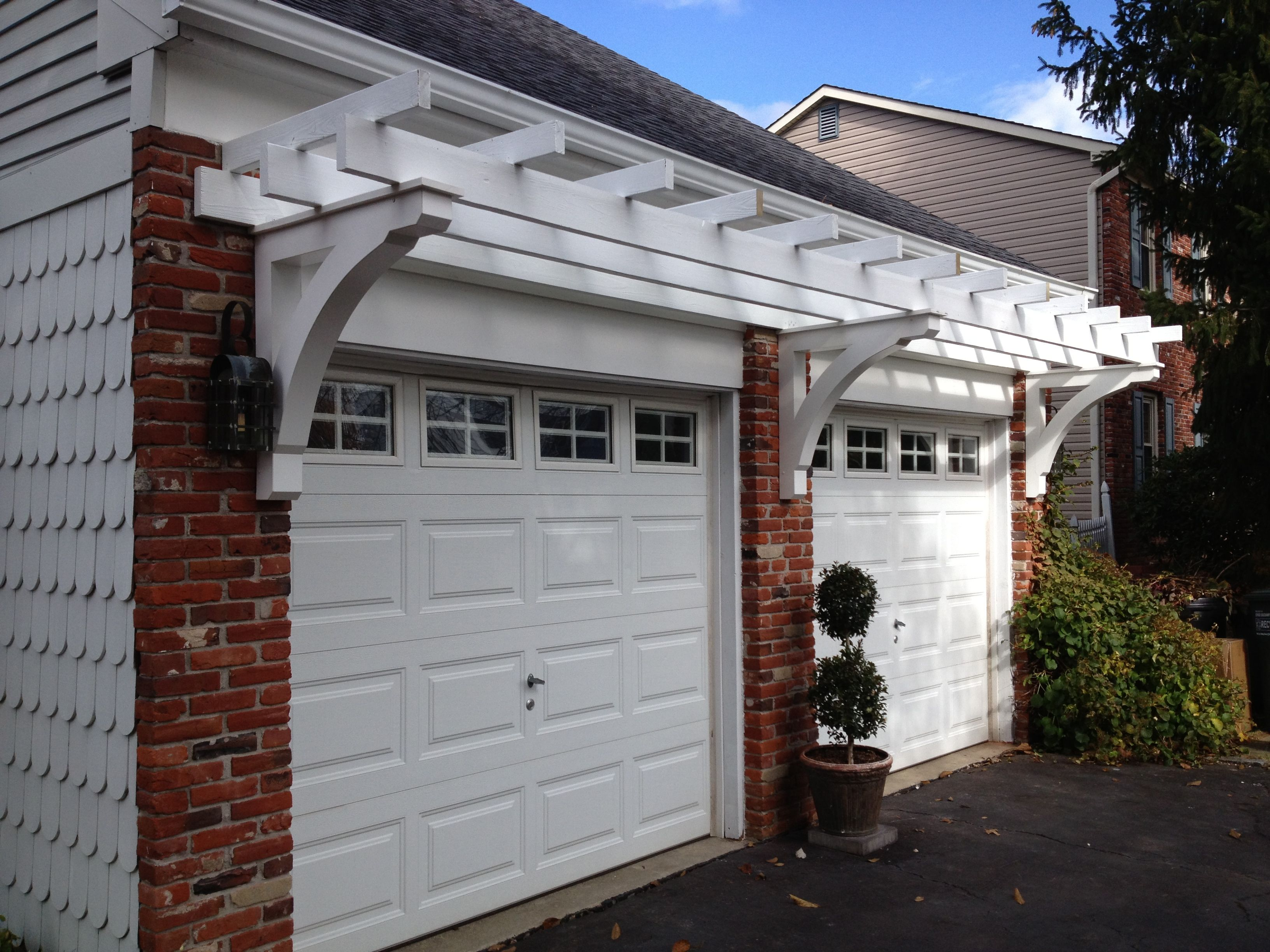 Pergola over garage door gallery photos diy ideas for Attached garage kits