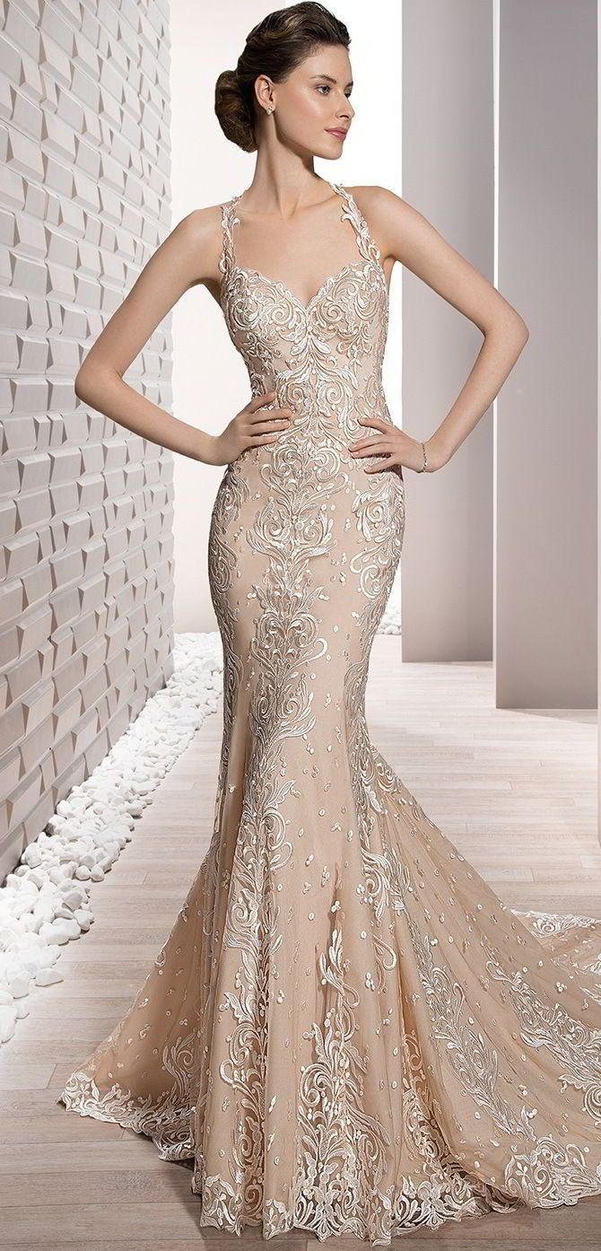 Embroidered Venice lace adorns this form fitting sheath Halter gown with Sweetheart neckline and delicate sheer lace low back finished with a Chapel train.