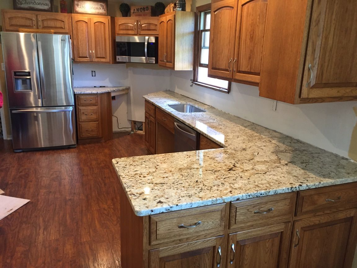 Image result for snowfall granite with oak cabinets ...