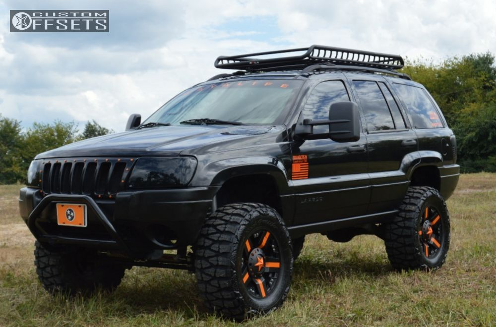 64 2 2004 Grand Cherokee Jeep Suspension Lift 6 Kmc Rockstars Black  Aggressive 1 Outside Fender