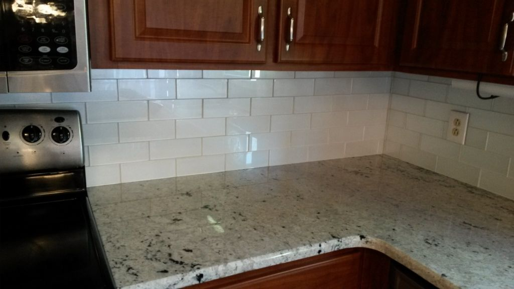 Colonial White Granite Counters With 3x8 Glass Arctic Glimmer Tile
