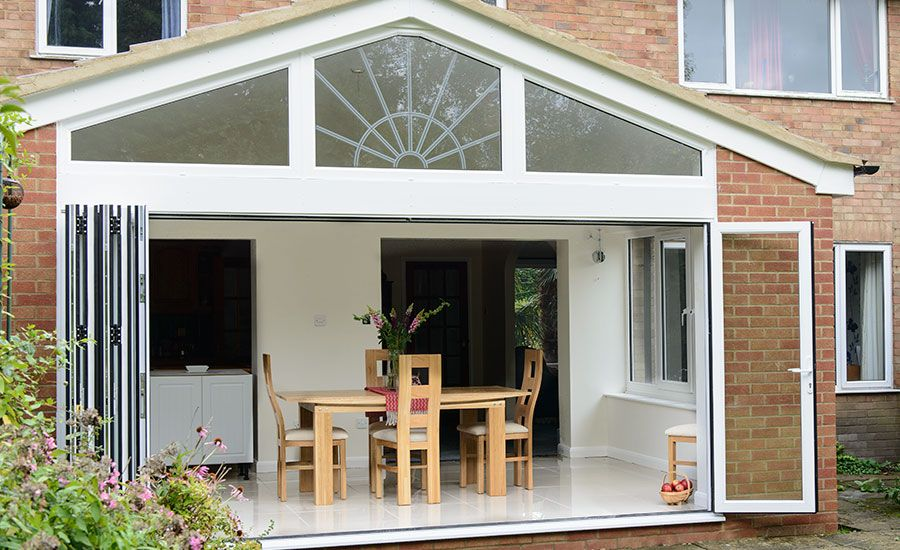 Extension with gable end and open Bi-Fold doors | Conservatories ...
