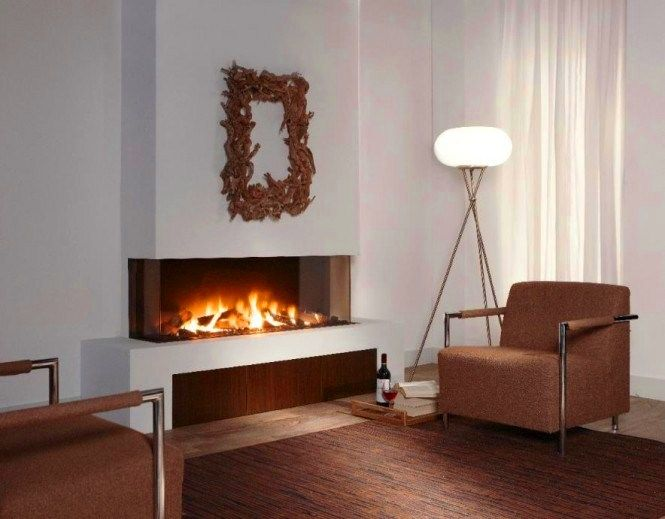 Amazing letterbox #fireplace. See more fireplaces designs at http://impressivemagazine.com/2013/10/27/minimalist-fireplaces-perfect-winter/
