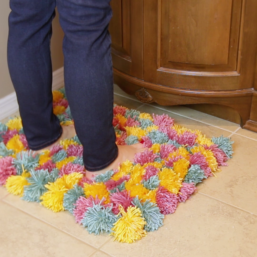 This fluffy pom pom rug is cozy af pom pom rug cozy and for Easy diy arts and crafts