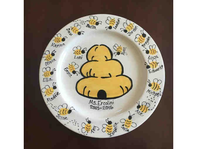 A Touch of Love This plate has been touched with love by each kindergartner. A parent volunteer worked with each student to help them press their fingers or thumbs onto the plate and capture their fingerprint as a special keepsake for their class...
