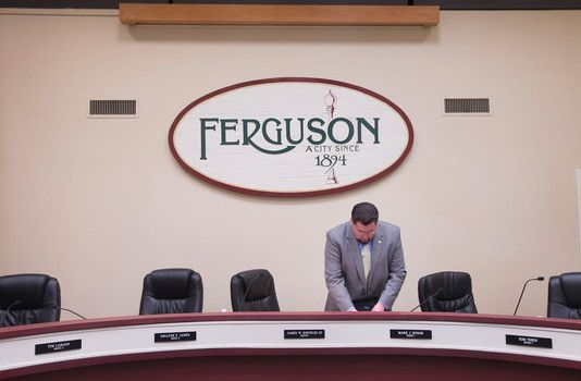 Ferguson citizens anxiously awaits  Grand Jury decision. Gun sales increase