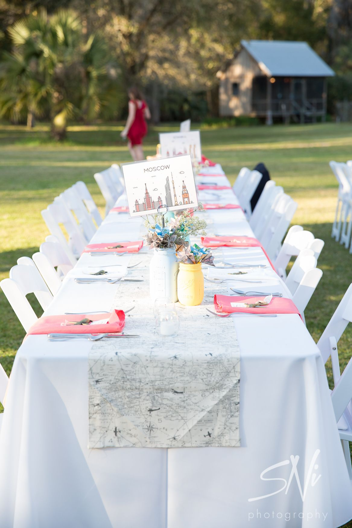 these favors are cool. I also like name tables after destinations I ...