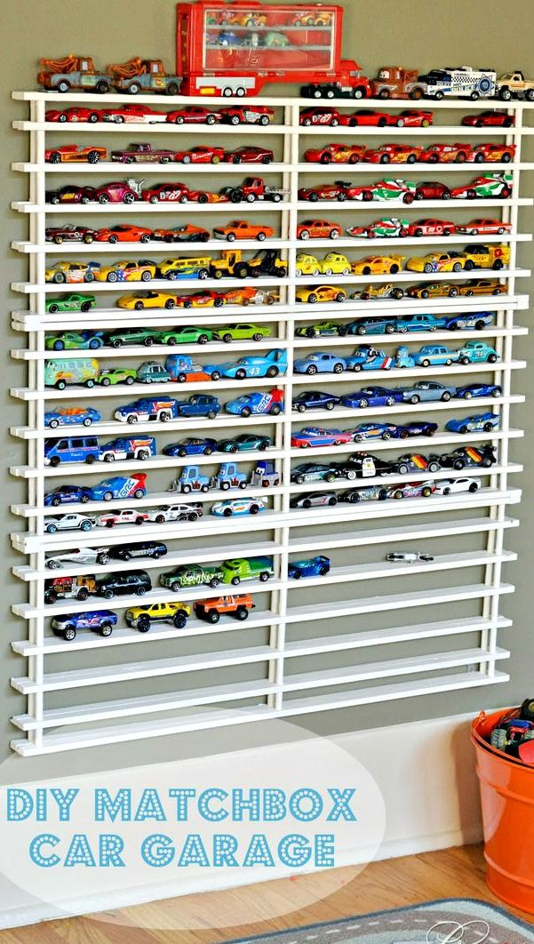 DIY Matchbox Car Garage. I love this for kids bedroom.