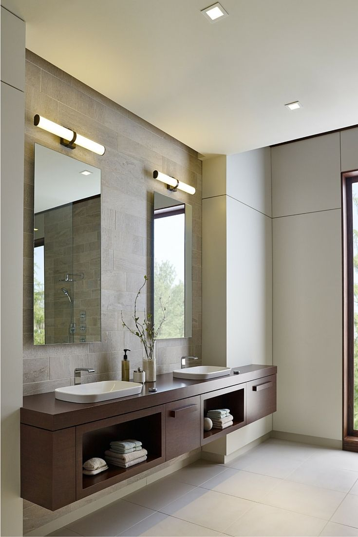 Traditional And Contemporary Design Blend Seamlessly In The Lynk 24 Bath Light From Lbl Lighting A Sleek Metal Band Matching Cast End Caps Embrace