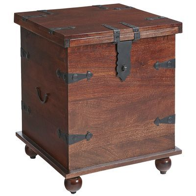 """Clever designing lands our Ridgeway Trunk under the heading """"stealth storage."""" Solid wood trunk features a rustic mahogany finish, crown and base molding, metal hardware and drop handles—but the <i>piece de resistance</i> is the sliding top, craftily disguised as a hinge top. Perfect for stashing all your valuables, as only the shrewdest intruder would guess."""