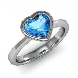 Heart Shape Blue Topaz Ring set in 18K White Gold. (7x7mm)