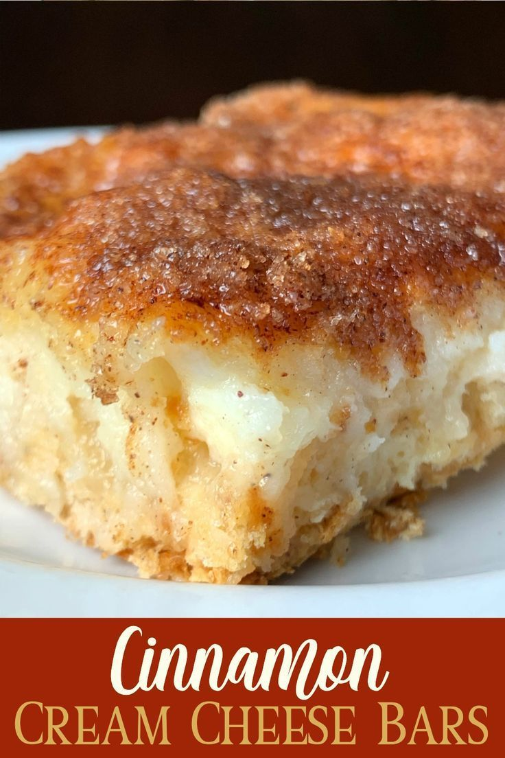 The cinnamon-sugar topping on Cinnamon Cream Cheese Bars reminds me of an elephant ear or churros. This dessert bar recipe is much easier to make at home with crescent roll dough and has a layer of cream cheese for extra goodness! #dessert #creamcheese #easyrecipeThe #cinnamon-sugar #topping #on #Cinnamon #Cream #Cheese #Bars #reminds #me #of #an #elephant #ear #or #churros. #This #dessert #bar #recipe #is #much #easier #to #make #at #home #with #crescent #roll #dough #and #has #a #layer #of #cr