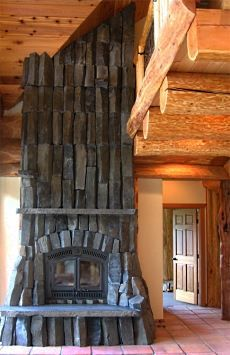 very unique use of #stone in the design of this #fireplace, ties