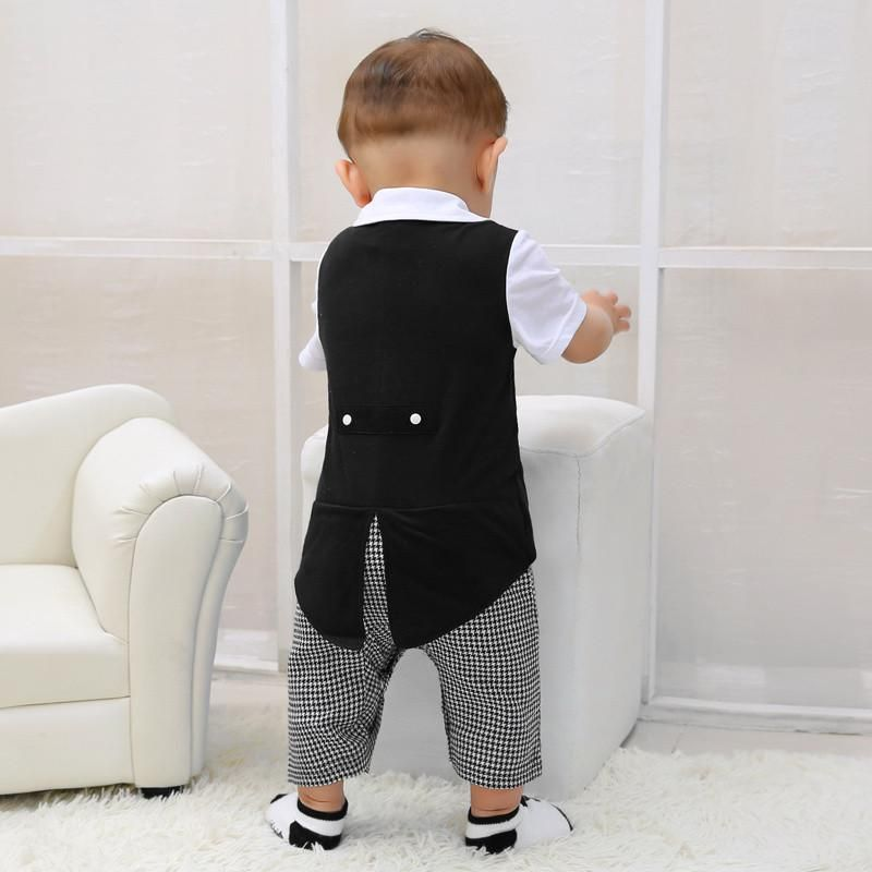 25c5444566c2 Parents, no need to mess with a four-piece suit for your little fox. This  one piece romper tux (that looks like a four-piece set!) makes diaper  changes a ...