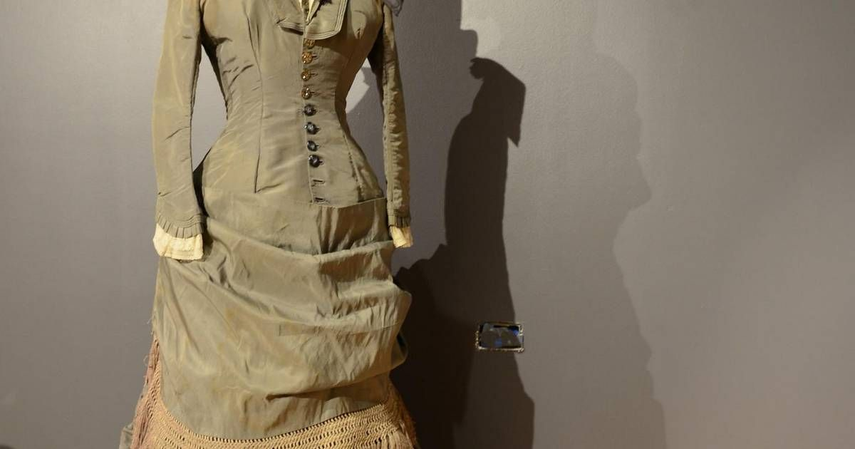 History museum exhibit features women's winter fashions.