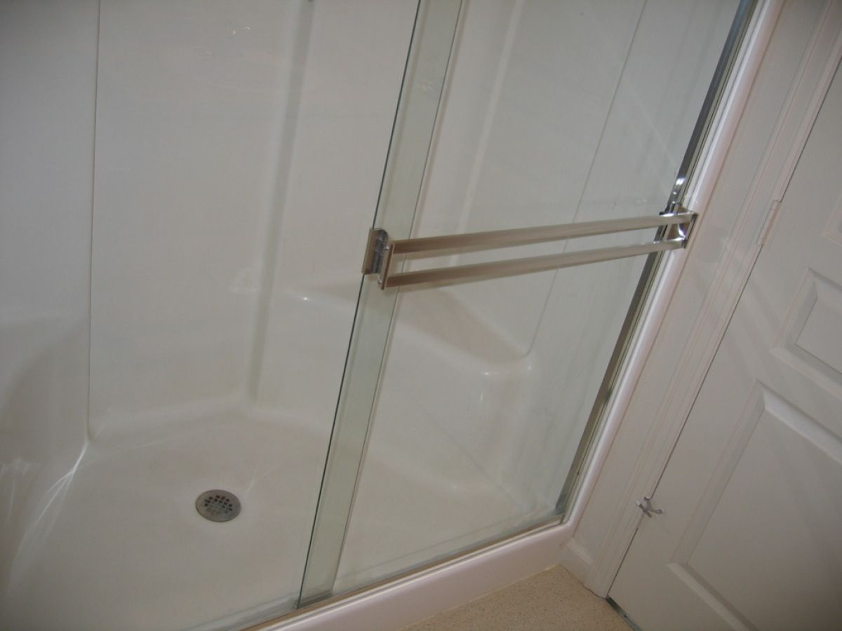 Removing Hard Water Stains From Glass Shower Door Use A Sponge And