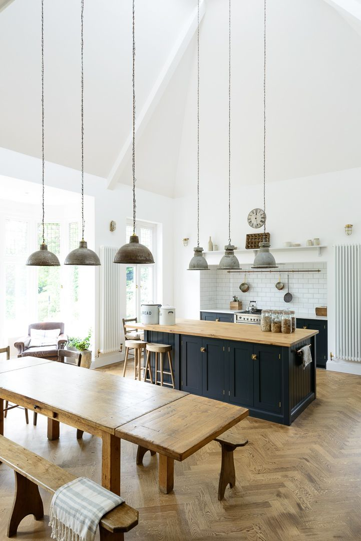 This lovely big kitchen in kent mixes vintage pendant lights original parquet flooring and beautiful devol shaker cabinets in pantry blue