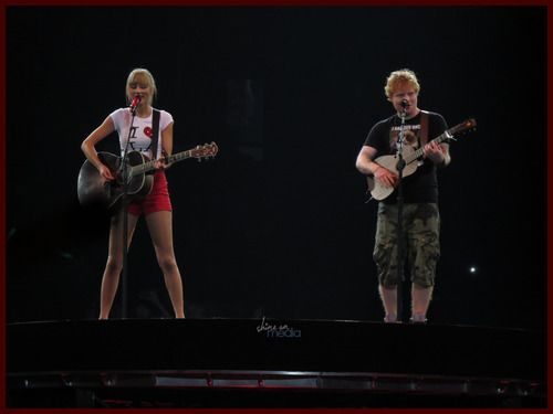 Taylor Swift and Ed Sheeran sing Everything Has Changed live @ Staples Center, LA.  {x} Lol look at Ed's shirt!   Grumpy Cat!